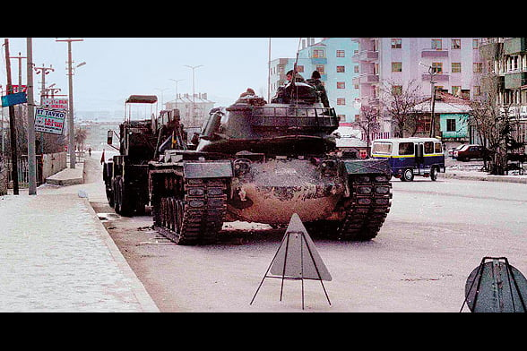 """On Feb. 4, 1997, military tanks rolled through Sincan in a show of power, a """"clear warning"""" to the government. (Photo: Today's Zaman)"""
