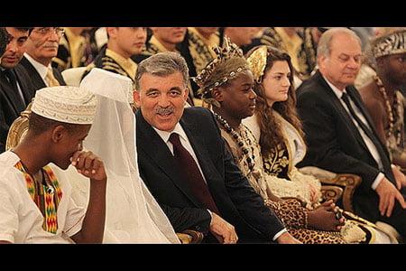 Turkish President Abdullah Gül is seen sitting among participants of Turkish Olympiads. (Photo: AA)