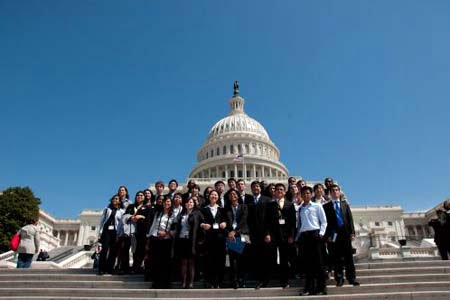 Former participants of the essay contest pose for a group photo in Washington DC.