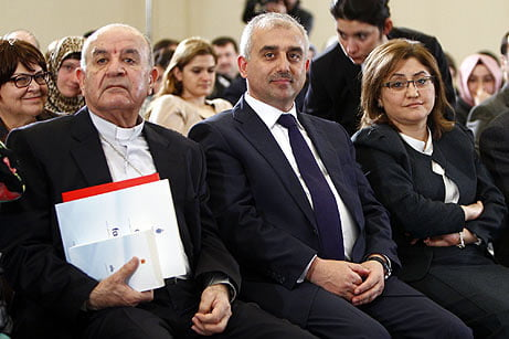 """Family and Social Policy Minister Fatma Şahin (2nd L) and GYV Chairman Mustafa Yeşil (2nd L) pose at the beginning of an international conference titled """"Family and Community Violence"""" in İstanbul on Nov. 24, 2012. (Photo: AA)"""
