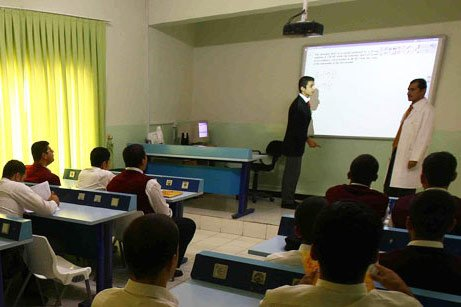 A student at one of the 30 Turkish schools in Iraq answers questions from his teacher in front of the board while other students follow. (Photo: Today's Zaman, Kürşat Bayhan)