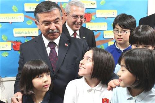 Turkish Minister of National Defense Ismet Yilmaz is with student at Jingumae International Exchange School
