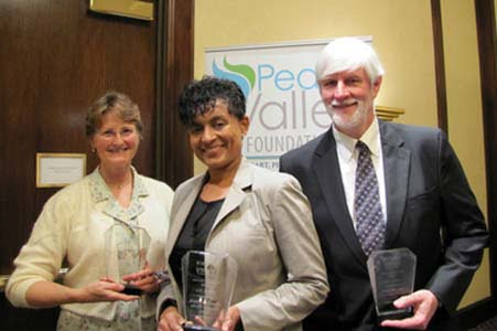 Kay Campbell, religion reporter for The Huntsville Times, at left, joins Huntsville High School teacher Chanda Davis and the Rev. Frank Broyles as honorees for Community Service in Media, Education and Community Service, respectively, by the Peace Valley Foundation, a non-profit education organization dedicated to building communication and understanding among all people. Huntsville, Ala., Thursday, April 18, 2013. (Courtesy of the Rev. Dr. Wanda Gail Campbell)