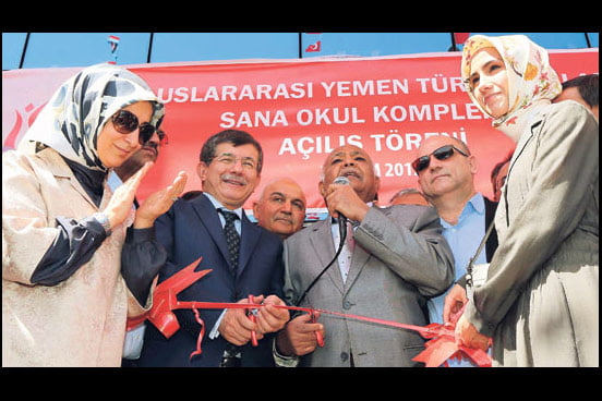 Foreign Minister Ahmet Davutoğlu (2nd from right) together with his spouse (1st from left) and Prime Minister Recep Tayyip Erdoğan's daughter Sümeyye Erdoğan as well as Yemeni Prime Minister Muhammad Salim Ba-Sindwah attended the inauguration of the Turkish International School in Yemen on Sunday. (Photo: AA)