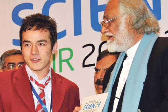 Habibullah Hal Muhammad is seen accepting his award from Education Minister Sardar Aseff Ahmed Ali.