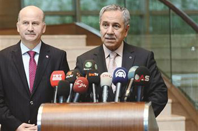 Deputy Prime Minister Bülent Arınç (R) is seen speaking at a press conference in Bursa, Nov 28. AA photo