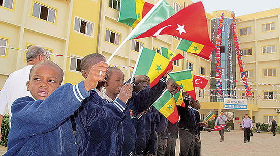 The Senegalese students are holding flags in front of their school (Photo: Sunday's Zaman)
