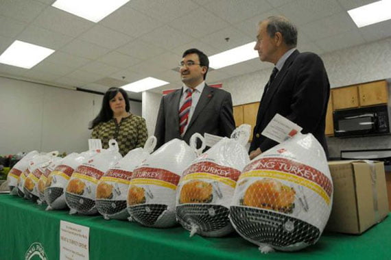Joanne Dwyer, left, director of food industry relations and business development for the Regional Food Bank of Northeastern New York, Veysel Ucan, center, executive director of the Turkish Cultural Center Albany, and State Assemblyman Bob Reilly take part in a press event at the Regional Food Bank of Northeastern New York, on Tuesday, Nov. 22, 2011 in Albany, NY. Members of the Turkish Cultural Center Albany donated 500 pounds of packaged beef cutlets and turkeys to the food bank in celebration of the Muslim holiday Feast of Sacrifice, Eid ul Adha and for the Thanksgiving holiday. Ucan said that the donation was a way for the Turkish American community to show their shared values for the whole community. Dwyer said that they send items to 1,000 non-profits in 23 counties and through those organizations 250,000 people are helped each year.