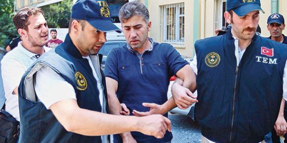 Police officer Tamer Özyılmaz, detained as part of a pre-dawn operation which included massive police arrests, is brought to Haseki Education and Research Hospital for a health screening. (Photo: Cihan, Kürşat Bayhan)