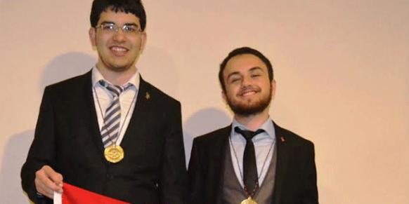 Osman Akar and Emre Girgin, who won a gold medal and a silver medal respectively at the 55th International Mathematical Olympiad (IMO), pose together in this July 13 photo. (Photo: Cihan)