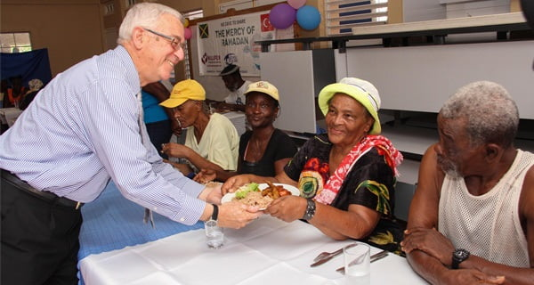 The education minister Mr. Thwaites in person served the food to the poor.