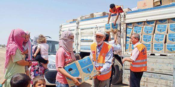 The Kimse Yok Mu charity provides humanitarian aid to Iraqi Kurds on Sept. 5, 2013.(Photo: Today's Zaman)