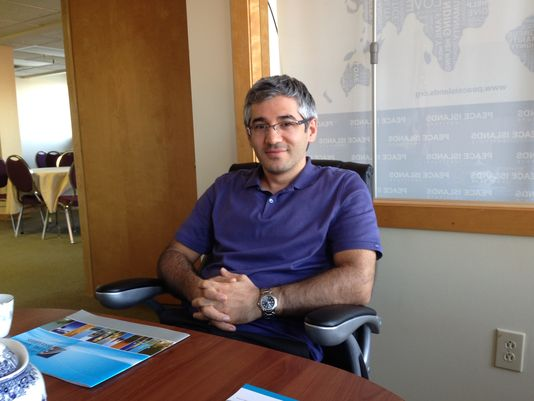 Adem G. Aydin, outreach coordinator, sits in a meeting room of Turkish Cultural Center Vermont, which opened its new office at the end of May. (Photo: TIM JOHNSON / FREE PRESS )