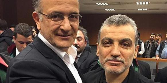 Zaman daily Editor-in-Chief Ekrem Dumanlı (L) and Samanyolu Broadcast Group head Hidayet Karaca (R) pose smiling at the camera after the announcement of the ruling. (Photo: Cihan)