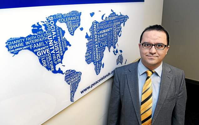 (Arnold Gold-New Haven Register) Mehmet Erdogdu, Director of the Connecticut chapter of the Peace Islands Institute, is photographed in the New Haven office on 3/10/2015.