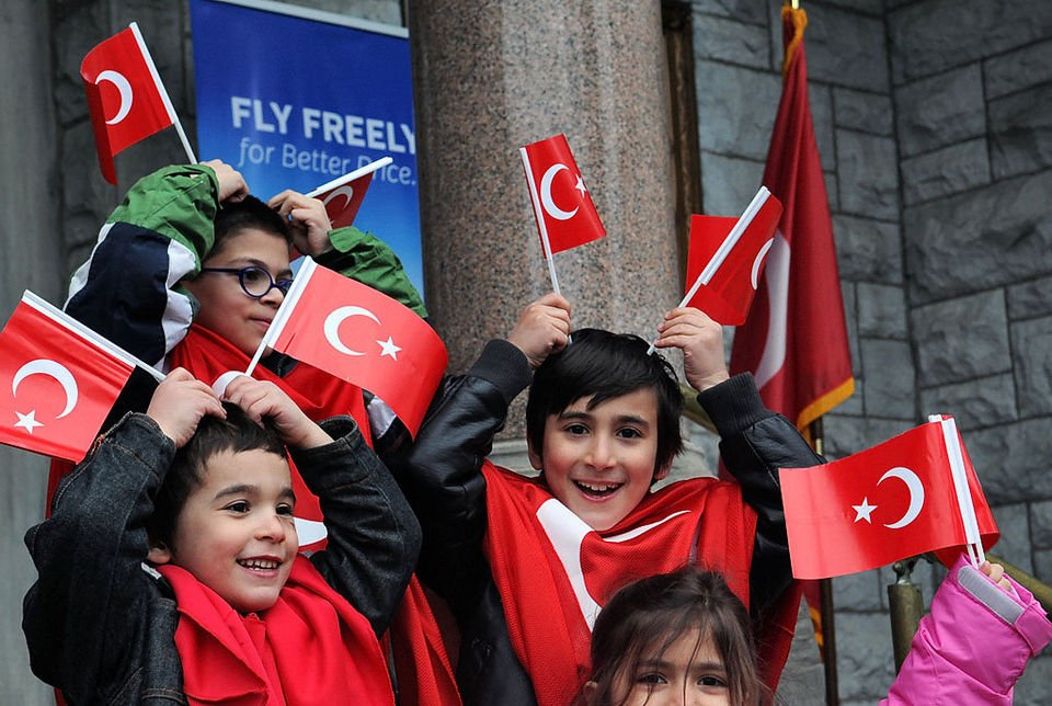 Children from the Turkish Cultural Center pose for pictures with Turkish flags during the first Turkish Day ceremony at Syracuse at City Hall. The event, with folk dances, Turkish cuisine and a proclamation by the Mayor's office, was organized by the local Turkish Cultural Center.  Stephen D. Cannerelli