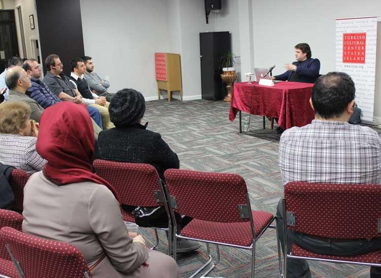 Turkish journalist Aydogan Vatandas speaks during an evening event titled,