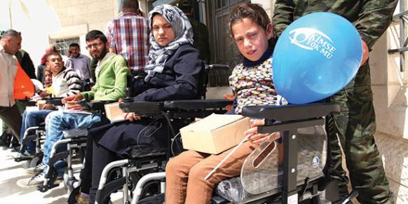 Turkish Relief Organization Kimse Yok Mu presented battery-powered cars to physically handicapped Palestinians.
