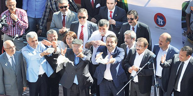 Labor Minister Faruk Çelik and the head of the CEM Foundation İzzettin Doğan are seen during the Groundbreaking ceremony of mosque-cemevi project.(Photo: Cihan)