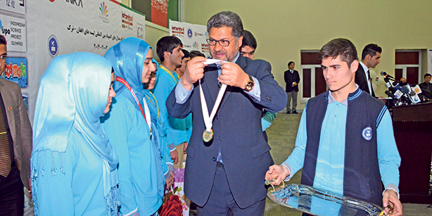 Students from a Turkish school in Afganistan receive medals in the International Science Olympics.