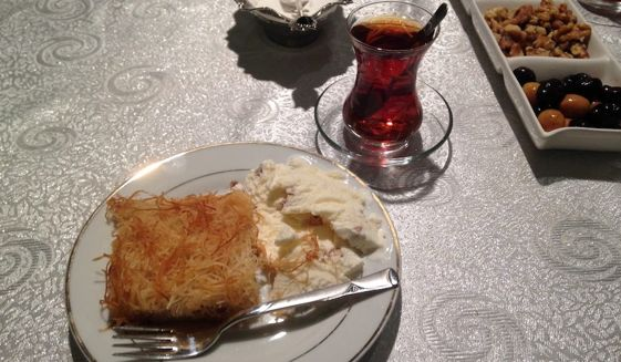 Turkish kadayif, a pastry dish similar to baklava, is offered as the dessert course of a traditional Muslim iftar, a fast-breaking meal served after sundown during the holy month of Ramadan, alongside cay, a tea drink. (By Emily Leslie/The Washington Times)