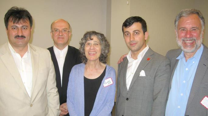 Among those at the interfaith dinner were Ibrahim Sayar, left, director of interfaith outreach at Peace Islands; the reed ney flute player, Yusuf Gurtas of Queensborough Community College; Peggy Kurtz, librarianat the Central Queens Y; Oguzhan Turan, executive director of the Turkish Cultural Center of Queens; and Walter Ruby, Muslim-Jewish program director at the Foundation for Ethnic Understanding.  / PHOTO BY DAVID SCHNEIER