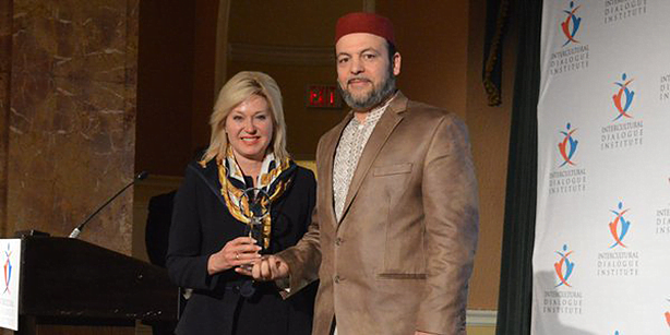 Dr. Slimi receiving the Interfaith Award.