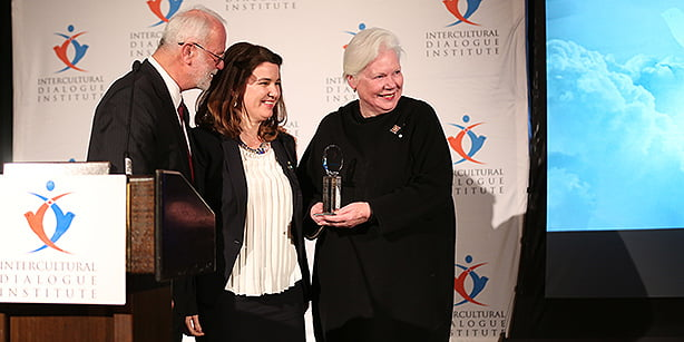 Filmmaker Andree Cazabon (C) receives the Distinguished Leadership Award, presented by Lieutenant Governor of Ontario Elizabeth Dowdeswell (R) and Brian Brian Desbiens.