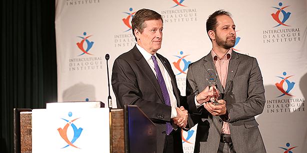 Mayor John Tory presents Community Service Award, given to Lifeline Syria group.