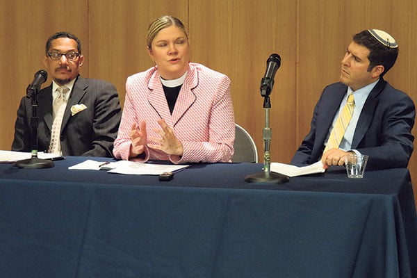 Panelists, from left, Imam W. Deen Shareef, Pastor Christa Compton, and Rabbi Jesse Olitzky, consider the religious implications of achieving peace. Photo by Robert Wiener