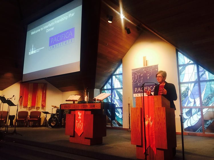 Redmond United Methodist Church pastor Lara Bolger speaks at Sunday's Interfaith Friendship Iftar Dinner.