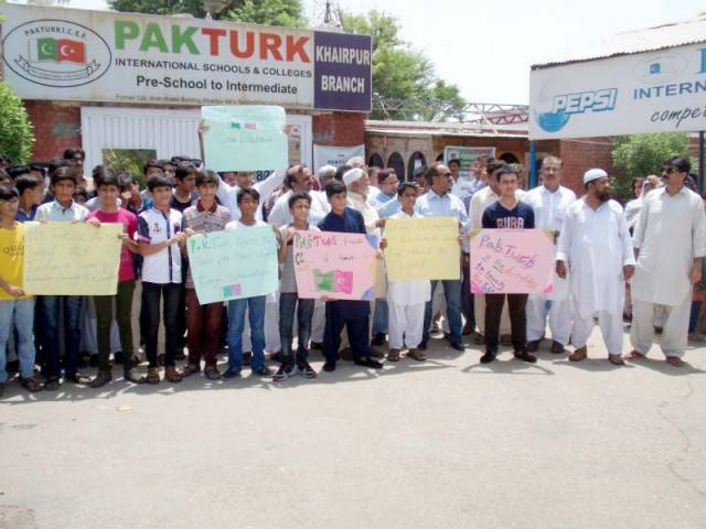 The students and their parents carried placards with slogans in favour of Pak-Turk School and expressed solidarity with the school management. PHOTO: EXPRESS