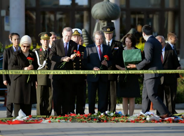 Erdogan at a memorial in front of Ankara's train station.