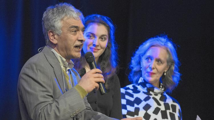 Ibrahim Parlak speaks to the crowd before a February 2016 benefit concert performed by Jeff Tweedy, lead singer of the Chicago band Wilco, in southwest Michigan. Parlak is fighting U.S. government attempts to deport him to Turkey. (Mark Davis / Pioneer Press)
