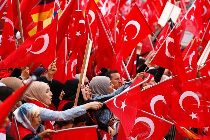 PHOTO: Gulen followers are harassed by supporters of Turkey's President Reccep Tayyip Erdogan. (Reuters: Thilo Schmuelgen)