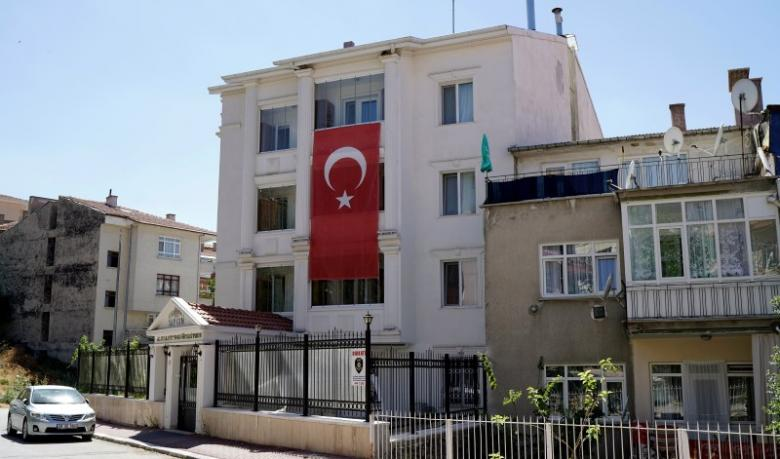 A Turkey's national flag hangs on the facade of a girls dormitory which was sealed by Turkish authorities over alleged links to the followers of U.S. based cleric Fethullah Gulen, who Turkey accused of staging a coup attempt in July, in Ankara, Turkey, August 16, 2016. REUTERS/Umit Bektas