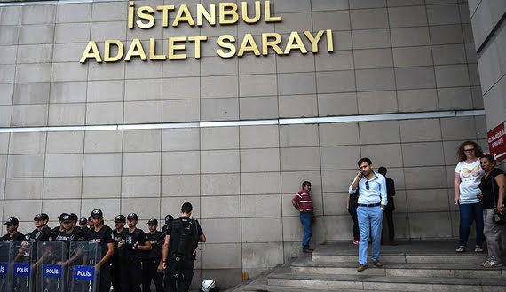 Turkish police stands guard in front of the Istanbul courthouse on July 20, 2016 following the military coup attempt of July 15. Turkish President Recep Tayyip Erdogan was today to chair a crunch security meeting in Ankara for the first time since the failed coup, with tens of thousands either detained or sacked from their jobs in a widening purge. / AFP / BULENT KILIC        (Photo credit should read BULENT KILIC/AFP/Getty Images)