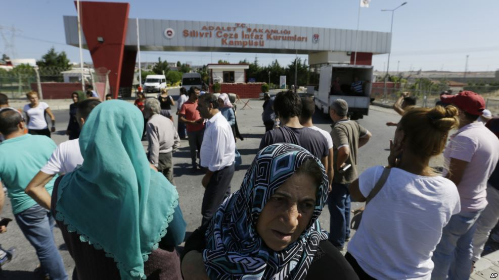 Relatives and friends of prisoners wait outside a high security prison complex in Silivri, about 80 kilometers (50 miles) west of Istanbul, Aug. 18, 2016.