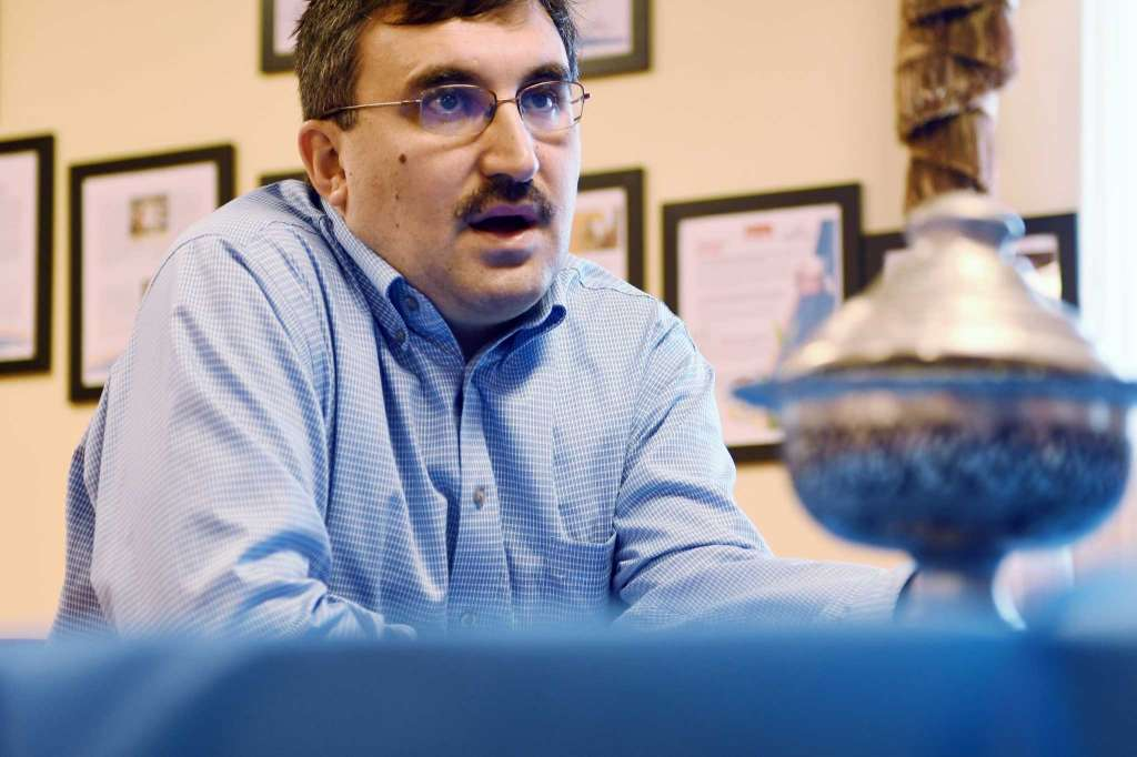 Veysel Ucan, executive director of the Turkish Cultural Center of Albany, talks about exiled Turkish Muslim clerk, Fetullah Gulen, during an interview on Wednesday, July 27, 2016, in Menands, N.Y. (Paul Buckowski / Times Union