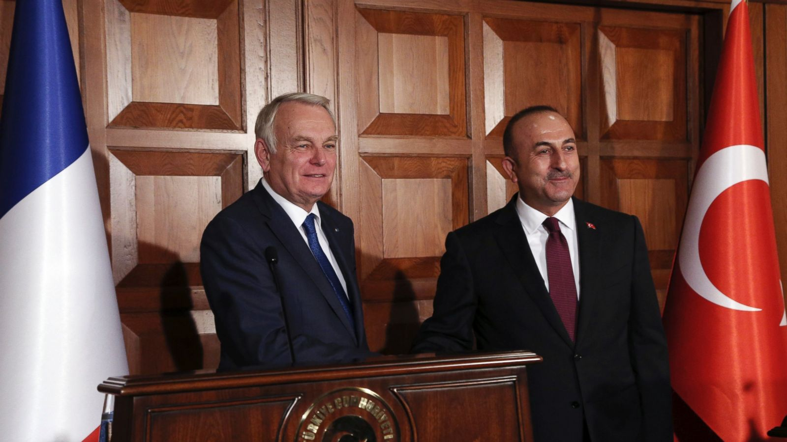 France's Foreign Minister Jean-Marc Ayrault, left, and his Turkish counterpart Mevlut Cavusoglu shake hands after a joint news conference in Ankara, Turkey, Monday, Oct. 24, 2016. Ayrault has called for an end of the