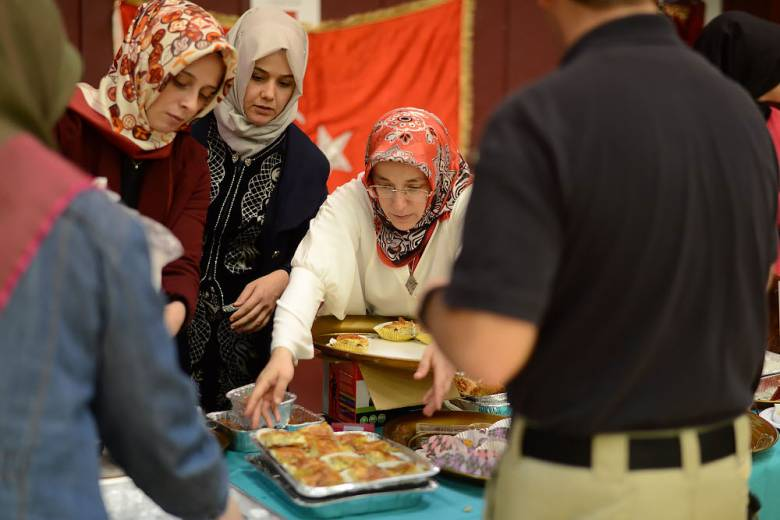 Women stop by the Turkish Cultural Center at the festival at Clifton High School on Saturday, Oct. 15, 2016. Photo: Carmine Galosso