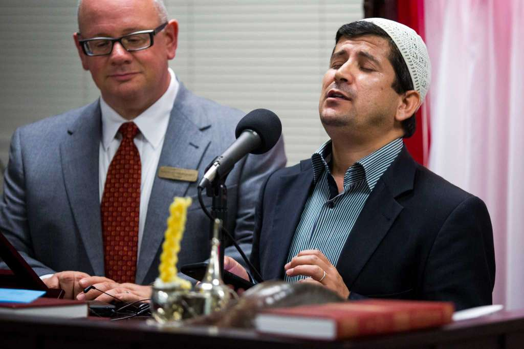 San Antonio, Texas -- October 12, 2016 -- Beytullah Colak, Imam of the San Antonio chapter of The Islamic Institute, sings a prayer with Rabbi David Komerofsky at his side during a dinner to break the Yom Kippur fast at Temple Chai. Ray Whitehouse / for the San Antonio Express-News