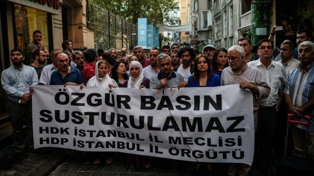 """The banner reads """"Free media cannot be silenced"""" - a protest after Ozgur Gundem was closed in August"""