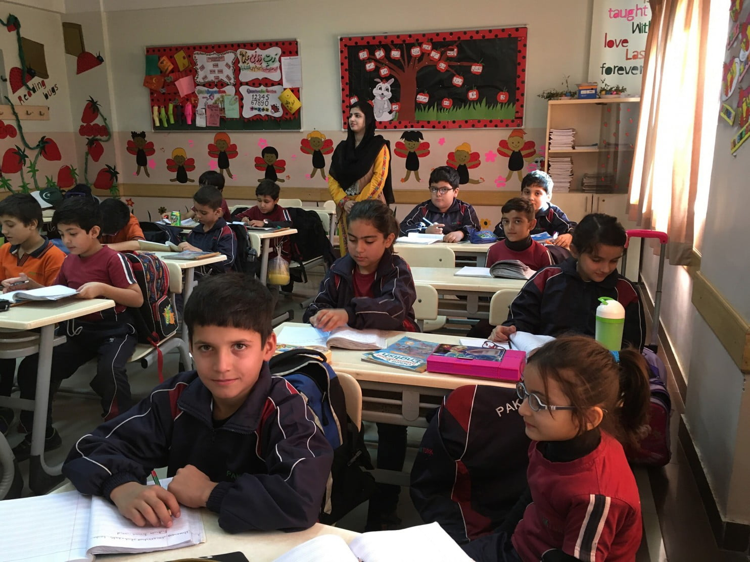 A second-grade English class at the PakTurk International School in Peshawar, Pakistan, is temporarily being taught by Pakistani teachers because the regular Turkish teachers are being told to leave the country. (Pam Constable/The Washington Post)