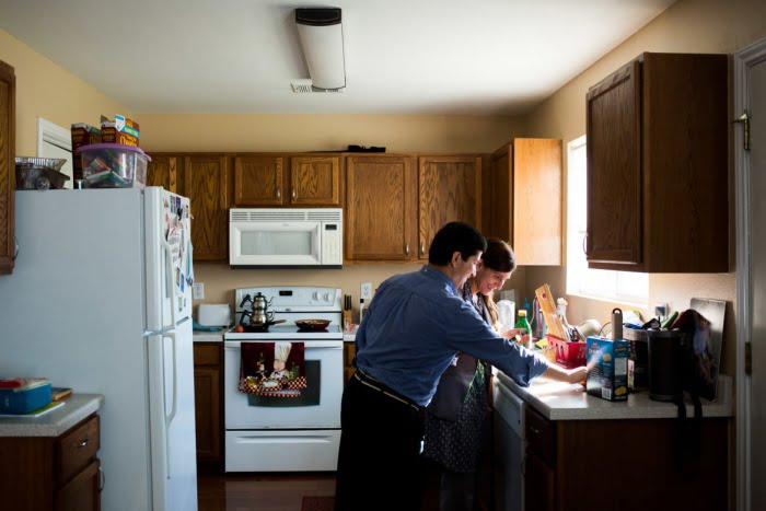 Beytullah and Gabriella Colak cook together in their kitchen. Photo: Kathryn Boyd-Batstone / Rivard Report