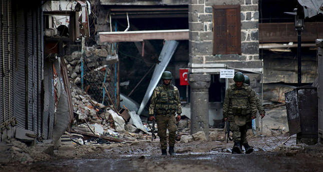 Turkish soldiers patrol in Sur district, which is partially under curfew, in the Kurdish-dominated southeastern city of Diyarbakir, Turkey February 26, 2016. REUTERS/Sertac Kayar