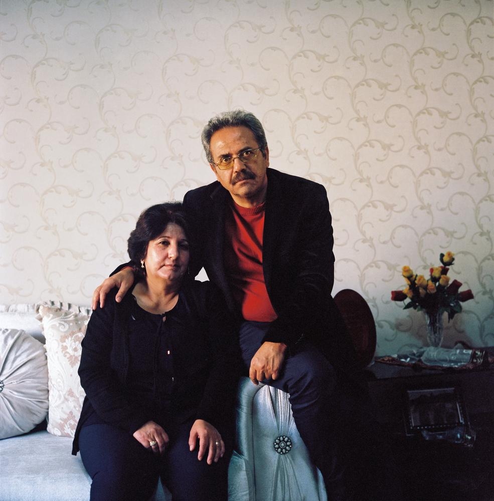 """Bulduk Sari, 51 years old, and his wife Elif. Mr. Sari is trying to clear his name and his employment record, but worries that this black mark will loom over his three sons and their future. """"Who will employ a son of a so-called traitor?"""" he asks. Konya, Turkey. November 5, 2011. CREDIT: Rena Effendi for the Wall Street Journal"""