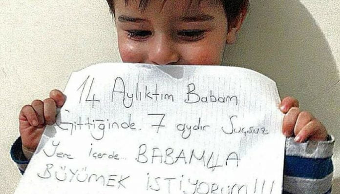 """""""I was 14 months old when my father was gone. He has been unfairly behind bars. I WANT TO GROW UP WITH MY FATHER!!!"""""""