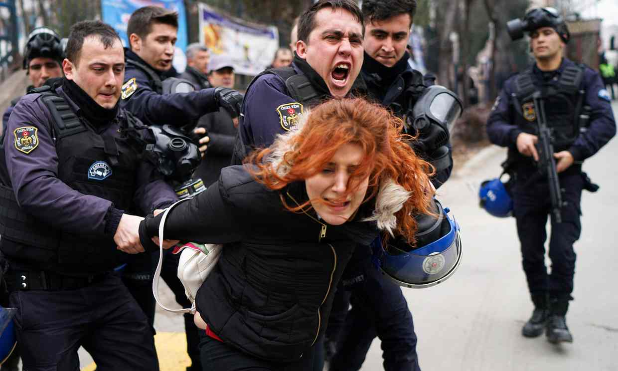 Riot police detain a demonstrator during a protest against the dismissal of academics from universities. Photograph: Umit Bektas/Reuters