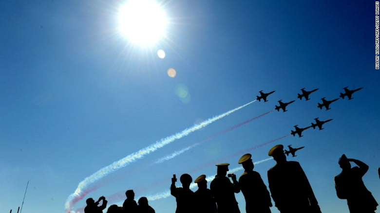 Turkish air force patrollers fly by as soldiers watch during a ceremony in April 2011.